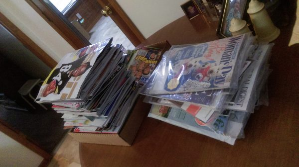 Photo: Two tall stacks of magazines sent by scam magazine agents