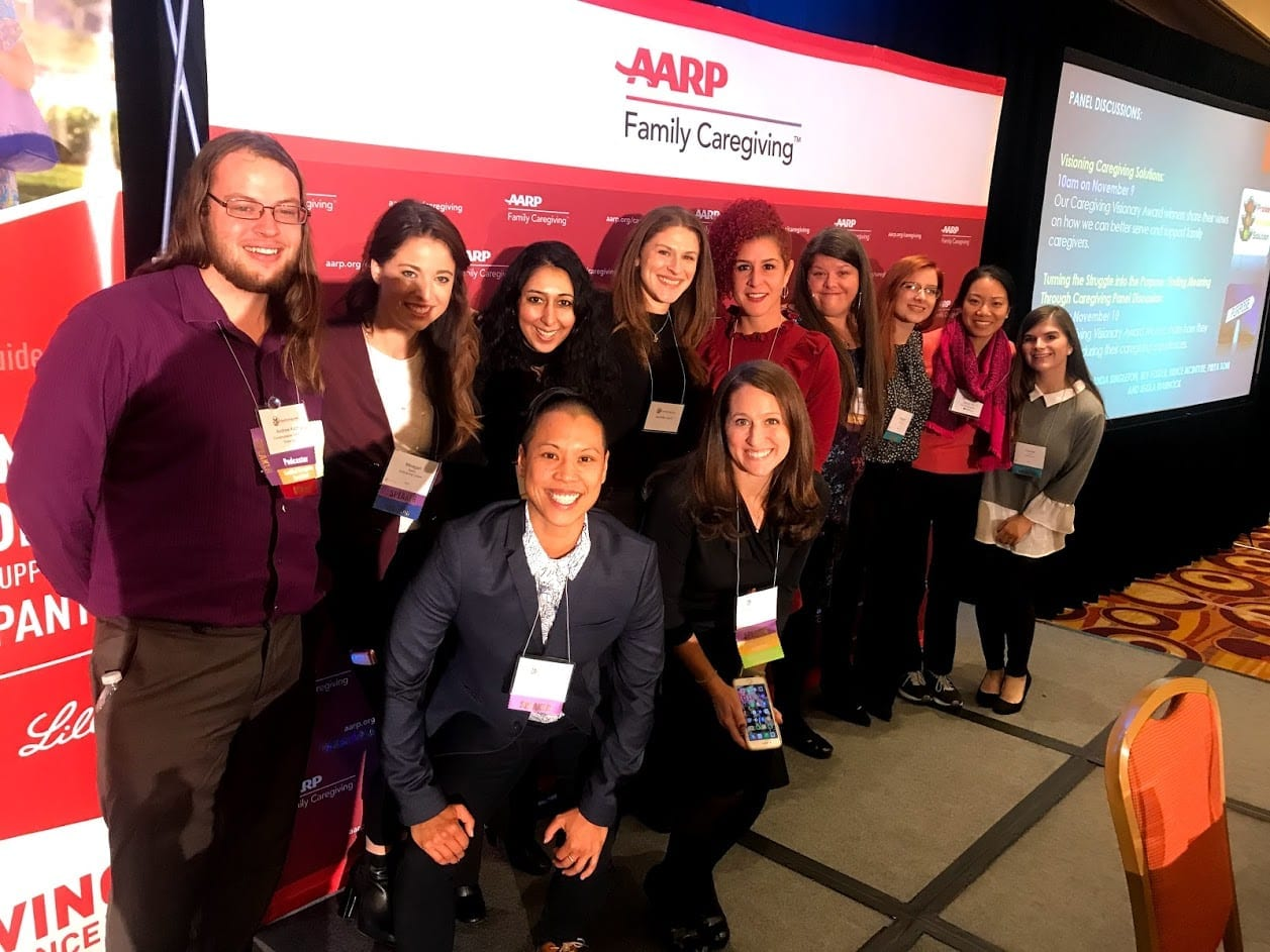 Photo: large group of millennial women and men at the National Caregiving Conference in 2018